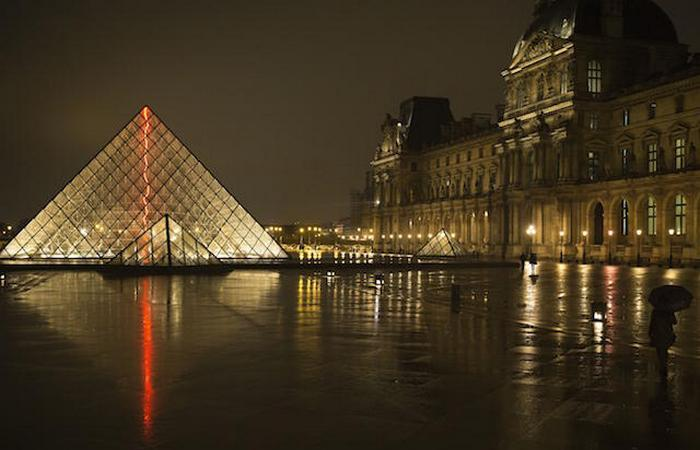 A view at night of the main entrance to the Louvre museum and its pyramid, on March 24, 2015 in Paris. AFP PHOTO / JOEL SAGET (Photo credit should read JOEL SAGET/AFP/Getty Images)
